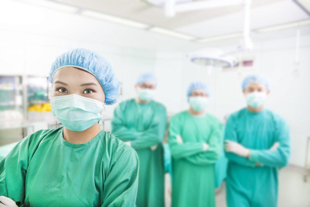 plastic surgeon specialists posing